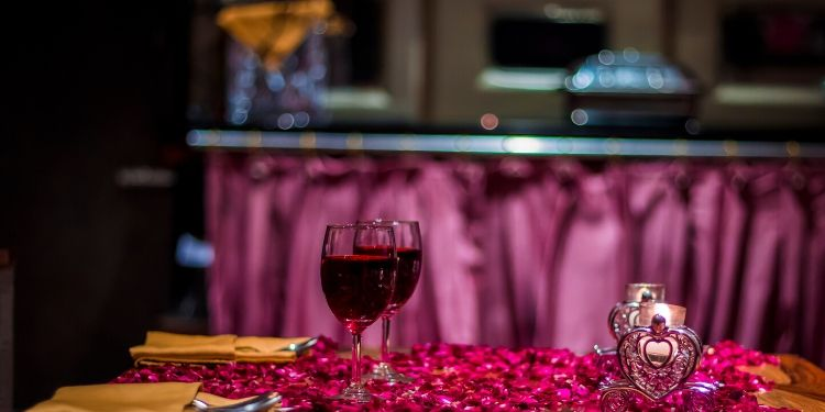 Nicely decorated table, with lots of romantic decoration like flower petals and candles