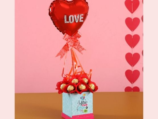 Send this beautiful arrangement of chocolates to show you care, simply and elegantly.