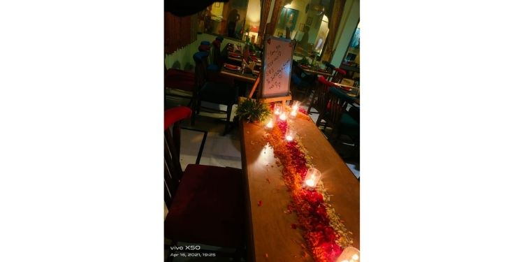 Candlelight Dining Bed of Flowers and Candles on Table