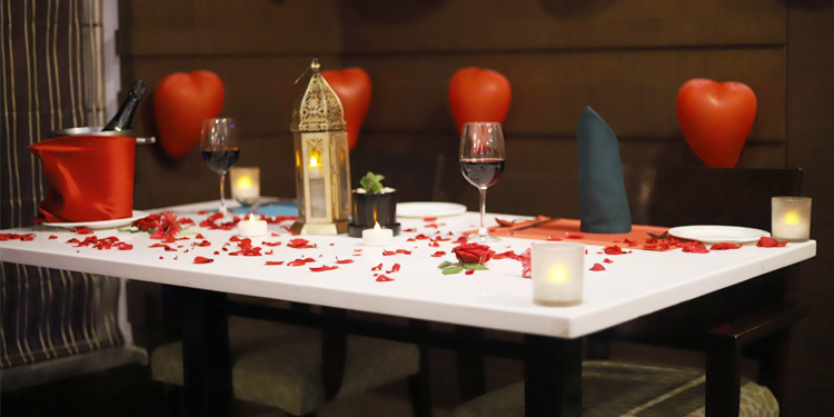 Decorated table with candles and rose petals in Bangalore