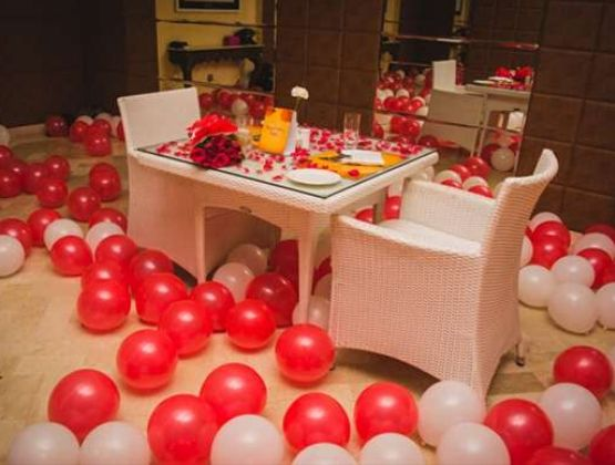 Nicely decorated private table, with lots of romantic decoration like flowers