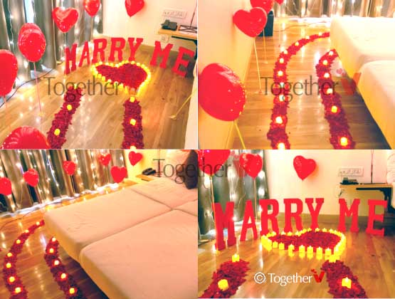 Marry Me or I Love You or Sorry thermocol letter, 1.5 Kg flower petals, 50 tea candles, 10 balloons with sticks