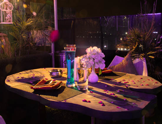 Breathtaking and mesmerizing setup on the rooftop with candles, flowers, aromas and special decoration.
