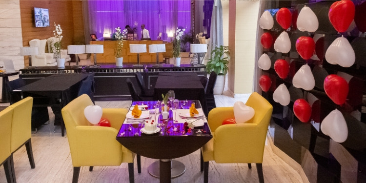 Candlelight dinner experience in Mumbai: Decorated table with flower petals and candles